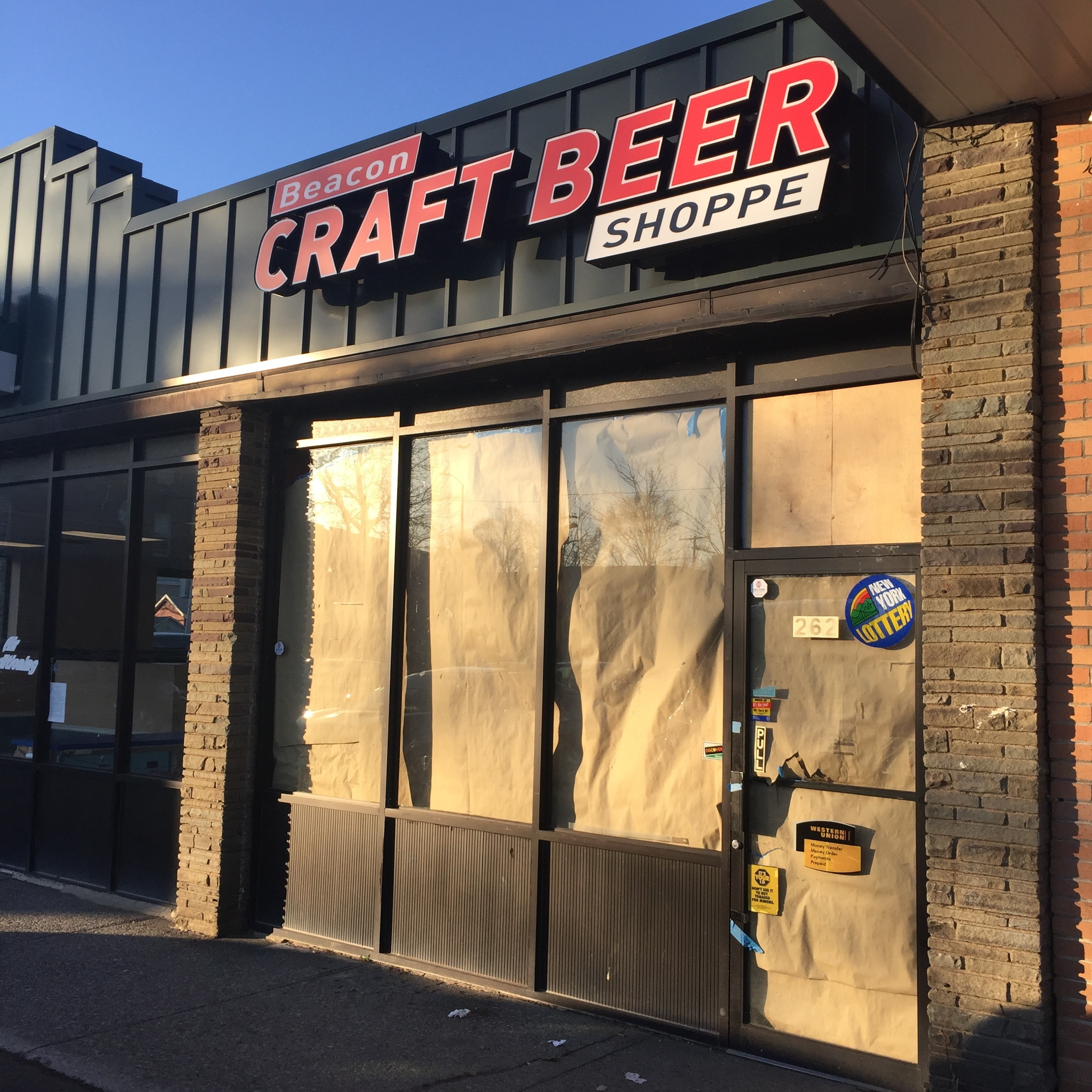 Regulars of the check-cashing store tried to enter the brown paper-covered door while the Craft Beer Shoppe was transforming.