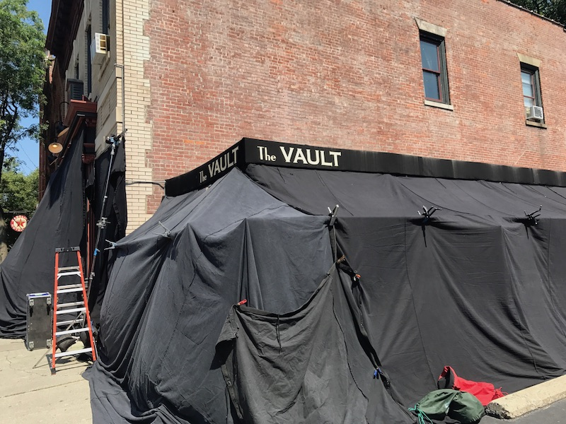 The Vault's patio is blacked out so that the production can control lighting for a scene being shot on the inside.  Photo Credit: Bruno Barros