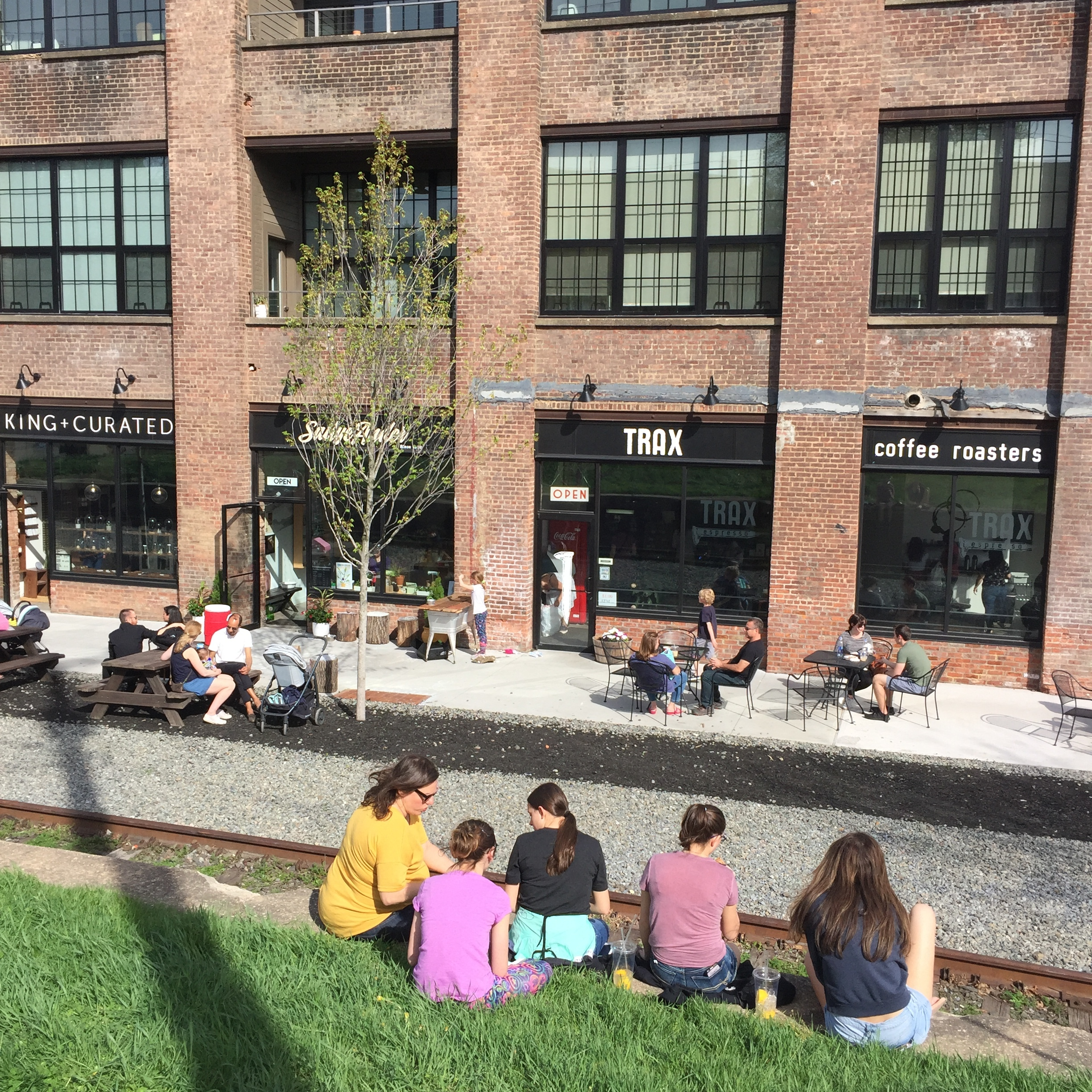 During Last year's Cupcake Festival, no one ventured down to 1 East Main, which is literally Just down a grassy hill from the Happenin' Event. This year, Since  Trax Coffee Roasters Has moved in , Cupcake Aficionados Were Happy to venture down the hill.  Photo Credit: Katie Hellmuth Martin