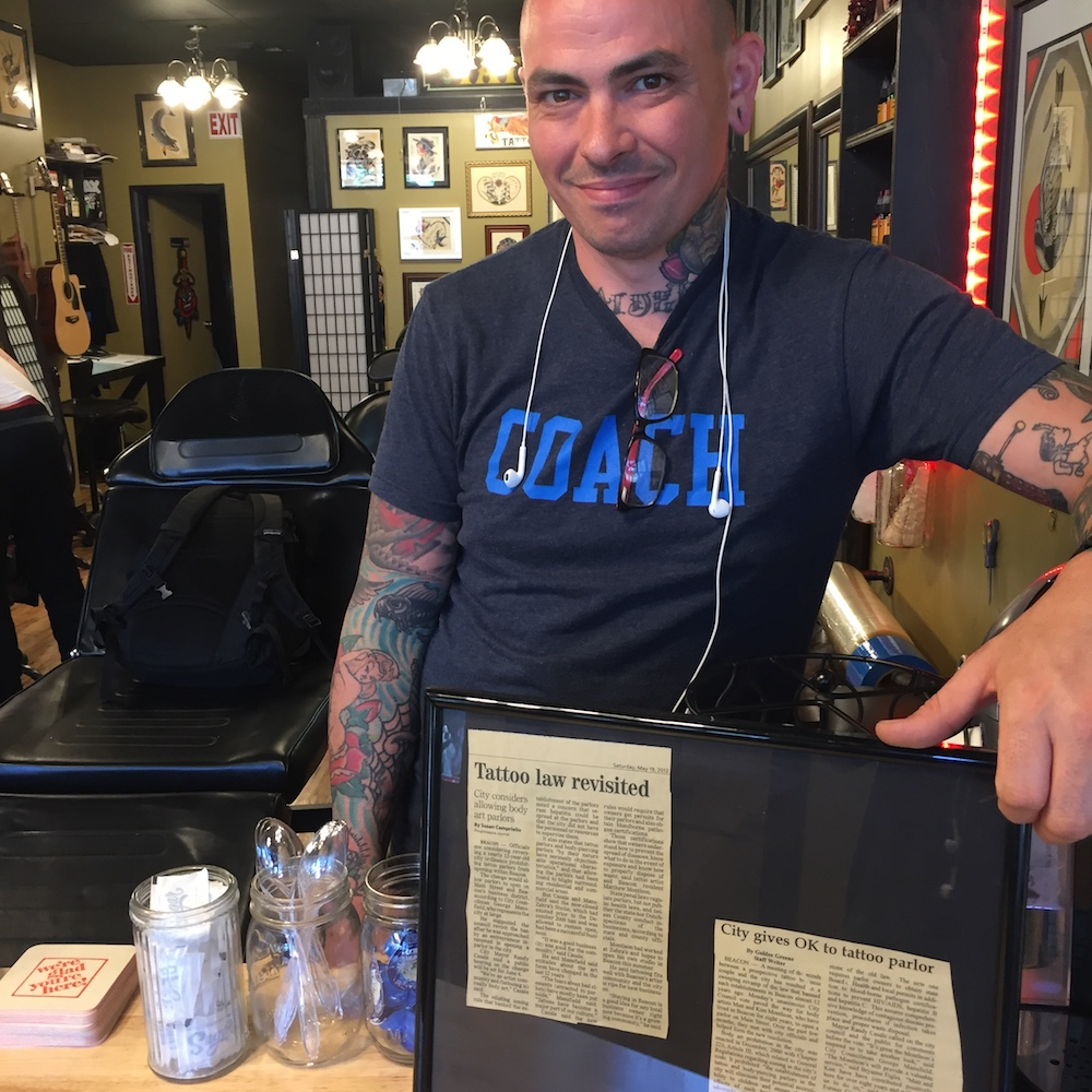 Matthew Montleon, owner of Honorable Ink, was responsible for instigating the reversal of a law that prohibited tattoo parlors in Beacon. There is no law written to prohibit short-term rentals in Beacon, but City Council voted down a law written to protect them, leaving short-term rental law in the gray and beholden to default law.  Photo Credit: Katie Hellmuth Martin
