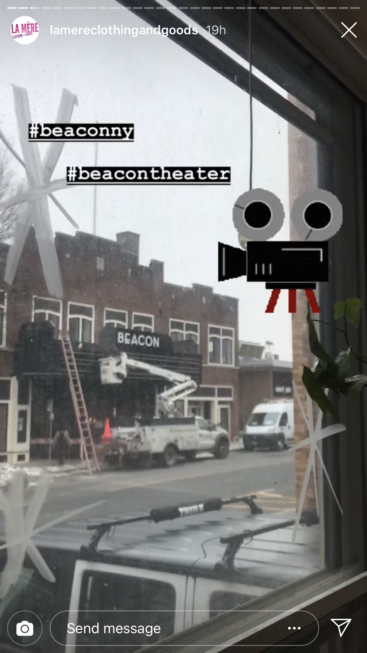 View from the storefront window of  La MÈre Clothing and Goods , located across the street from the theater. She published it on  her Instagram . Someone is excited!