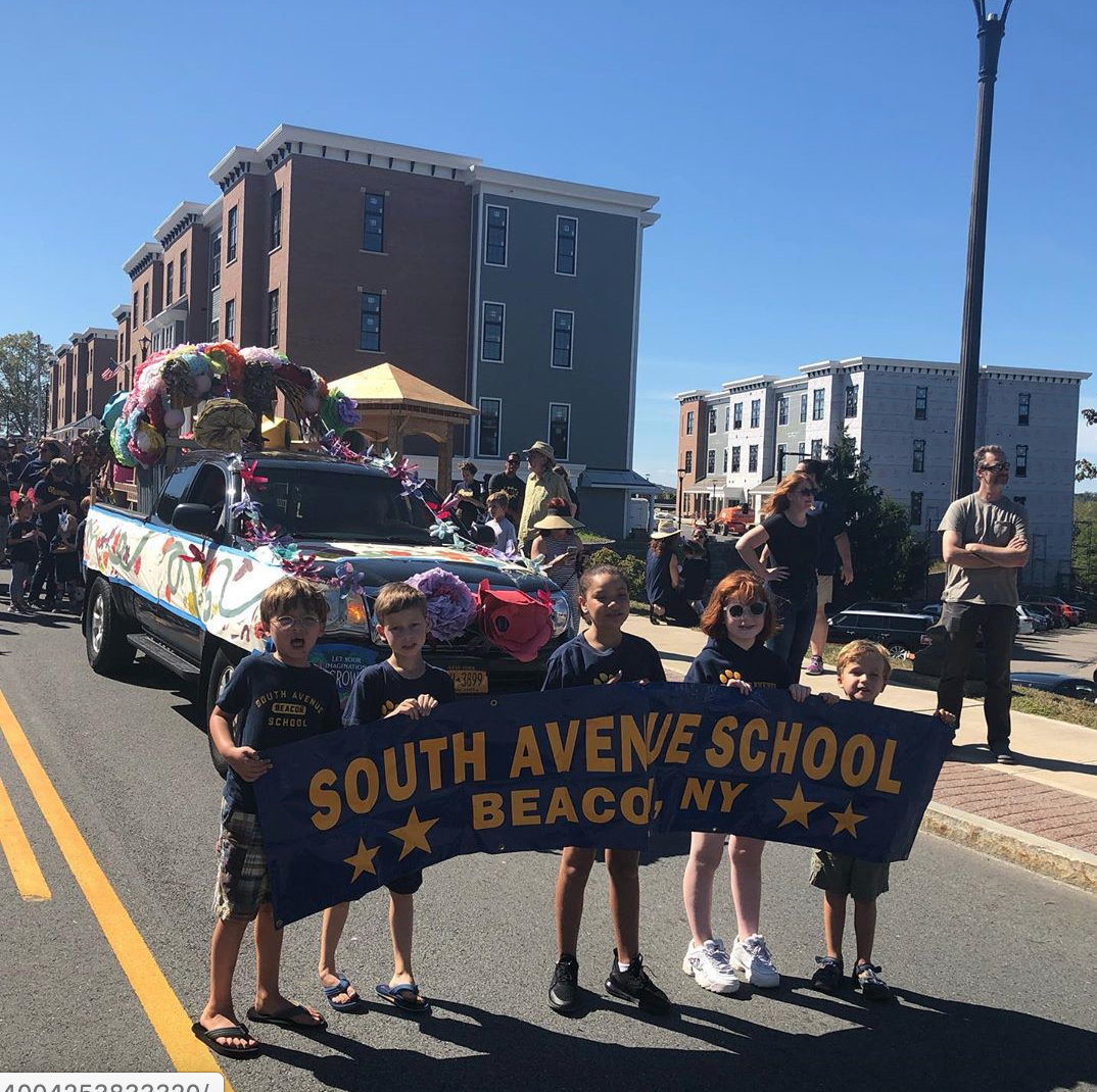 The lineup of the parade route, along 9D (aka Wolcott Ave.) with a view of how the new apartment buildings will play into future photos and screetscapes. Photo by  @Alittlebeacon
