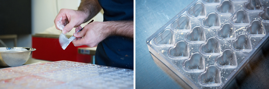 Julien splashes the first layer of white chocolate into the heart-shaped molds.