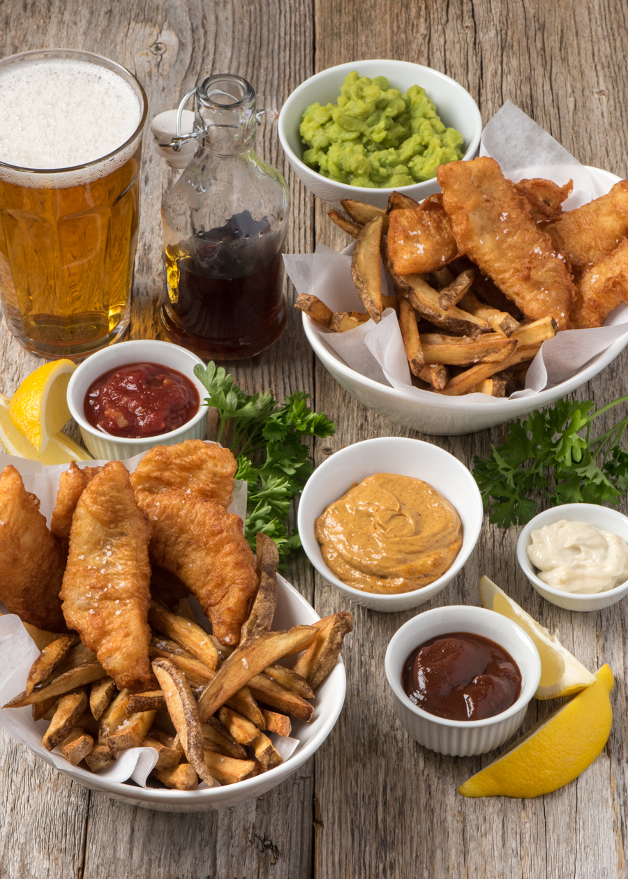 Fish & Chips served with ketchup, mushy peas, curry mayo, brown sauce and tartar sauce.