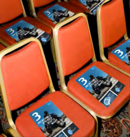 CHAIR TOPPER.  Ensuring EMC's top stories stay top of mind, we developed a slick, contextual conference leave-behind. As event-goers gather, they're disrupted by a high-quality printed bi-fold on their chair. One that's short enough to hold their interest, and long enough to be tucked away for the plane ride home.