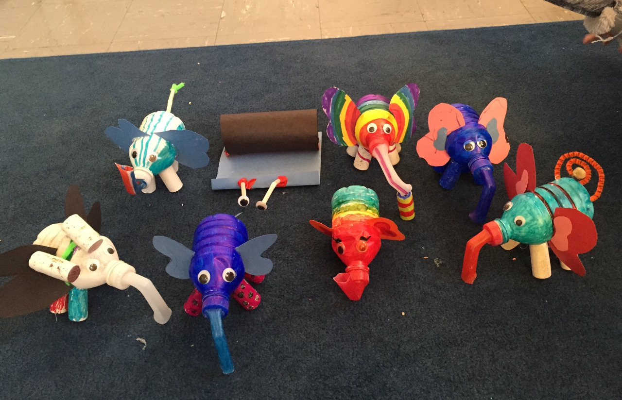 "Class 12 Results: I want to hang out with these guys!   First: ""I'm SLIGHTLY allergic to pollen,"" stated one of the kids. Relevant or not, we were off to make some elephants. Perhaps the most joyful collection of creatures yet—rainbows, polka dots, a jet pack for high flying antics (see white elephant on the left), and a snail???"