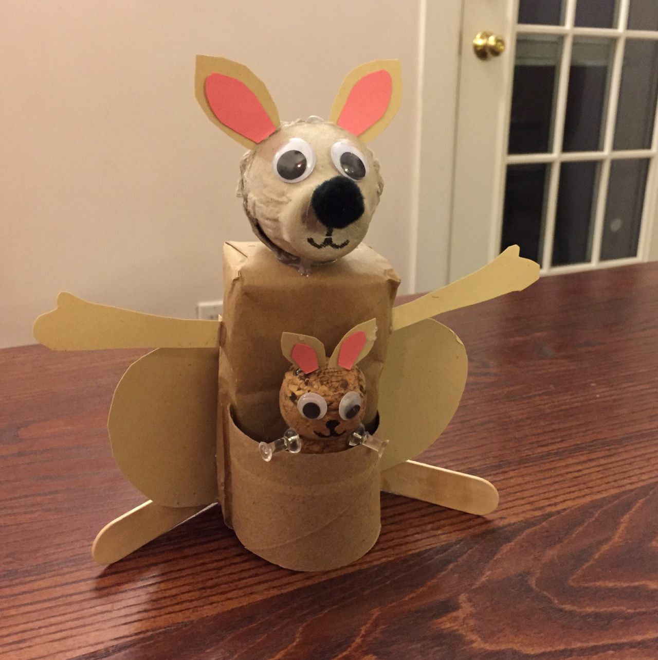 Class 13: Kangarooooo!   I thought the kids might like something involving a baby, so I hopped on this.   Juice box   Brown paper bag to wrap the juice box   Egg carton for the head  Champagne cork for the baby (No, I did not drink 11 bottles of Champagne — they're from wine store across the street)  Thumbtacks for baby's arms  Toilet paper roll for the pouch  Popsicle sticks