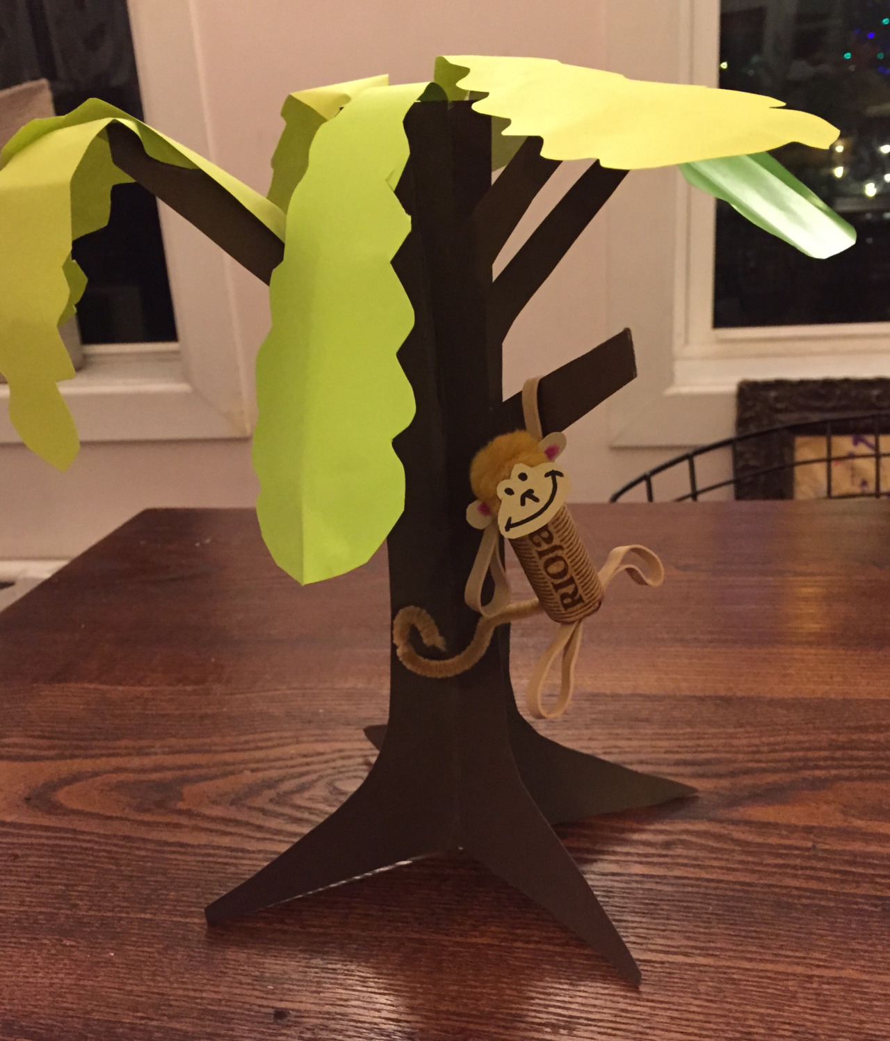 Class 11: Monkey and Tree    Nothing like hanging around, feeling groovy! I intended on using cardboard for the tree, but quickly realized that there's no way my kiddos would be able to cut through stiff board.    Construction paper - brown and green  Cork (monkey body)  Rubber bands for arms and legs, pinned to cork with thumbtack  Pom pom (head)  Pipe cleaner for tail