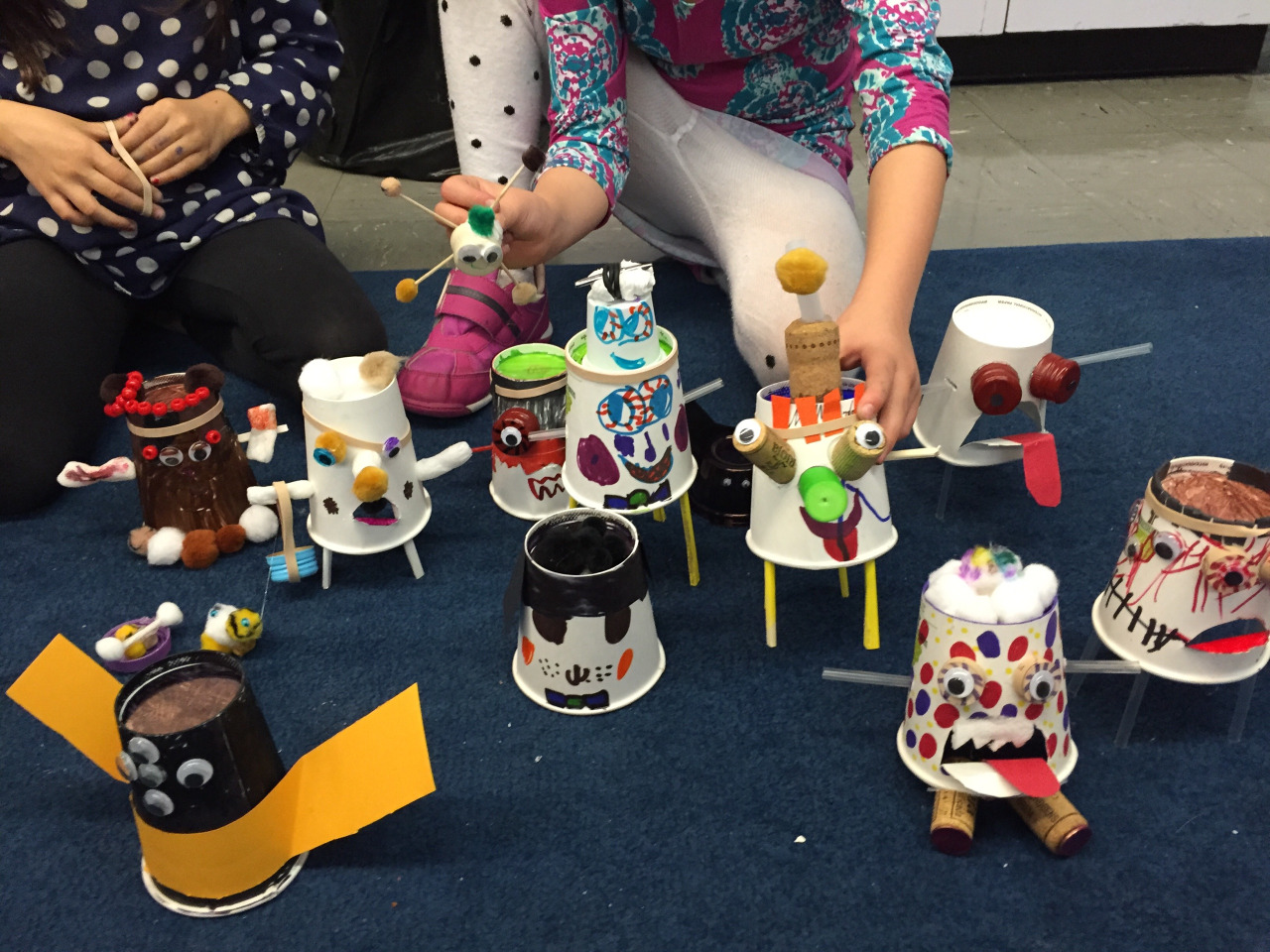 "Class 5 Results: Scary? Not so much.    Maybe it's not possible to convince ten girls to make creepy zombie creatures. My one boy spent almost the entire class coloring his cup black, and my uber creative girl made a purse for her zombie. I think someone even made food for her ""bunny"" zombie. And did I actually think there would be time for spiders?  Oh well. I tried."