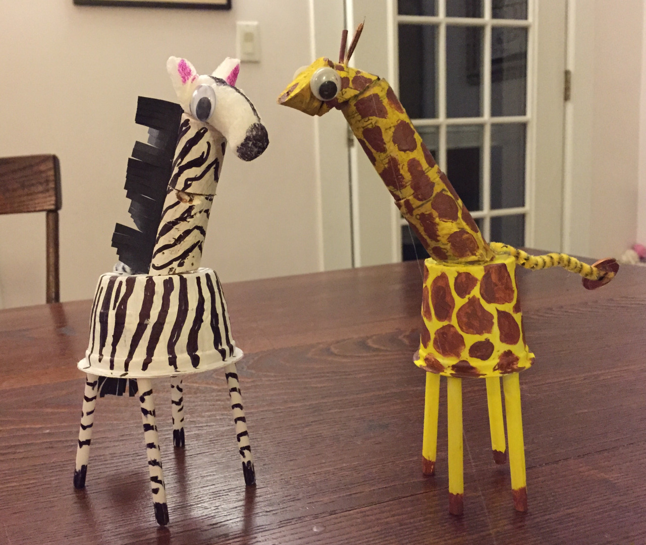 Class 4: Zebra or Giraffe   Not sure if this is a recipe for disaster — giving the kids a choice, but we'll see.   Applesauce container for the zebra   K cup for the giraffe  Corks! Some sliced on the diagonal for the neck  Straws and chopsticks for the legs.  Packing peanuts for the zebra's head  Penny for the giraffe's tail. Only because I needed a counter balance for the heavy cork neck!
