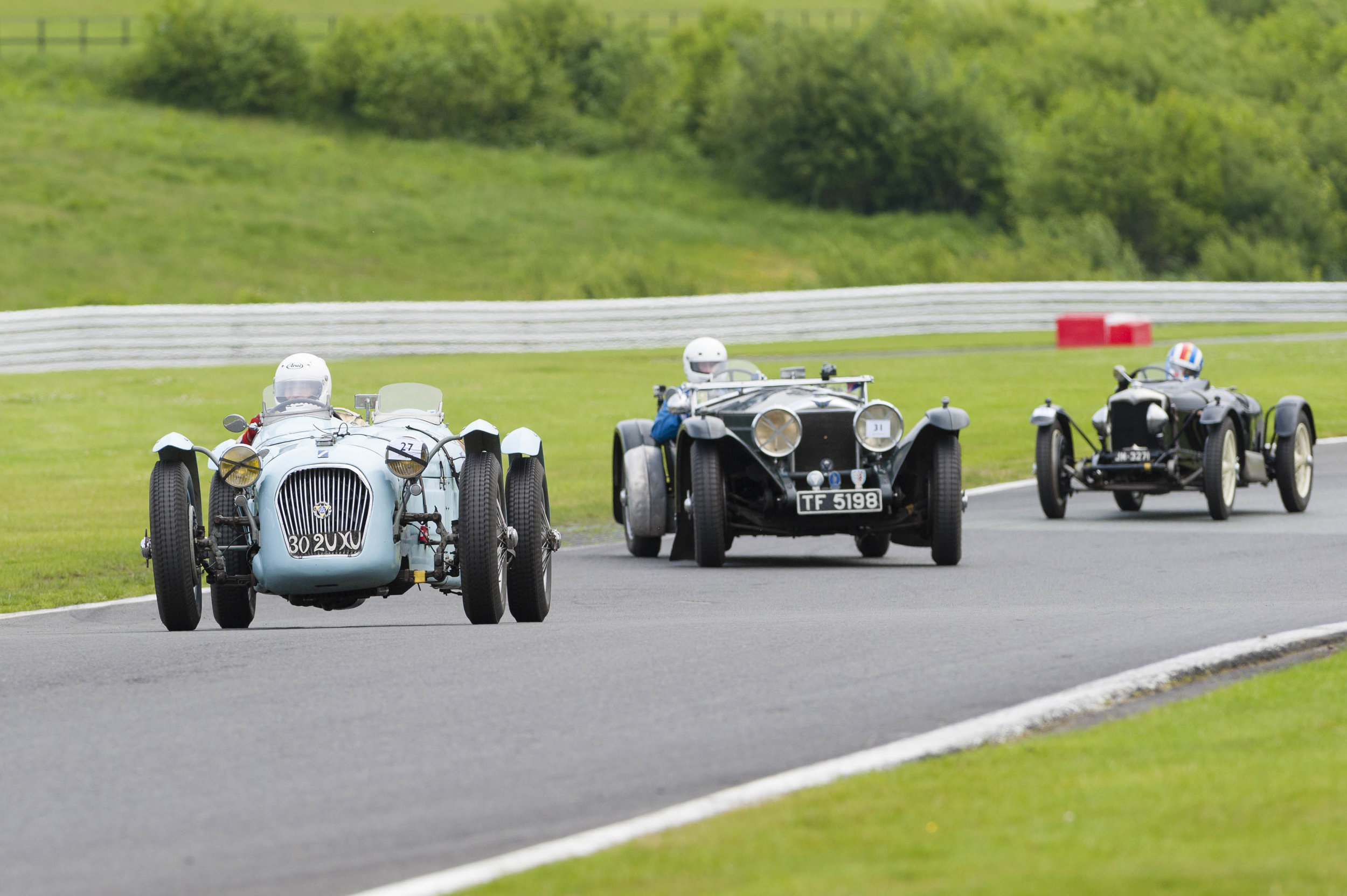 'Le Patron' Guyatt ahead of a sideways Swete, followed closely by Sharp, before losing his place to both:  Peter McFadyen