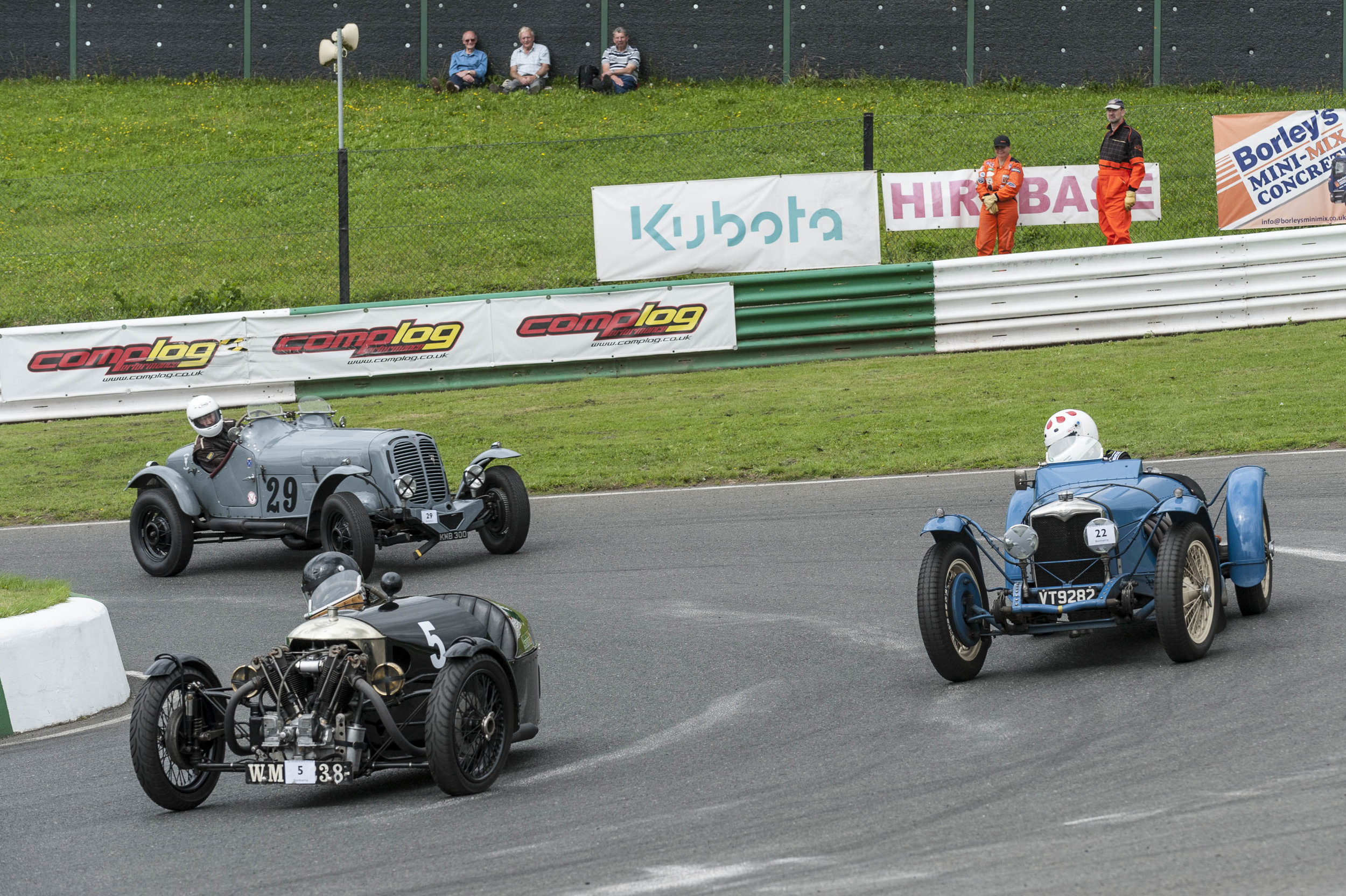 Darbyshire ahead momentarily in the Morgan, followed by race winner Kneller in the Riley Sprite and Brett, his front suspension deranged:  Peter McFadyen