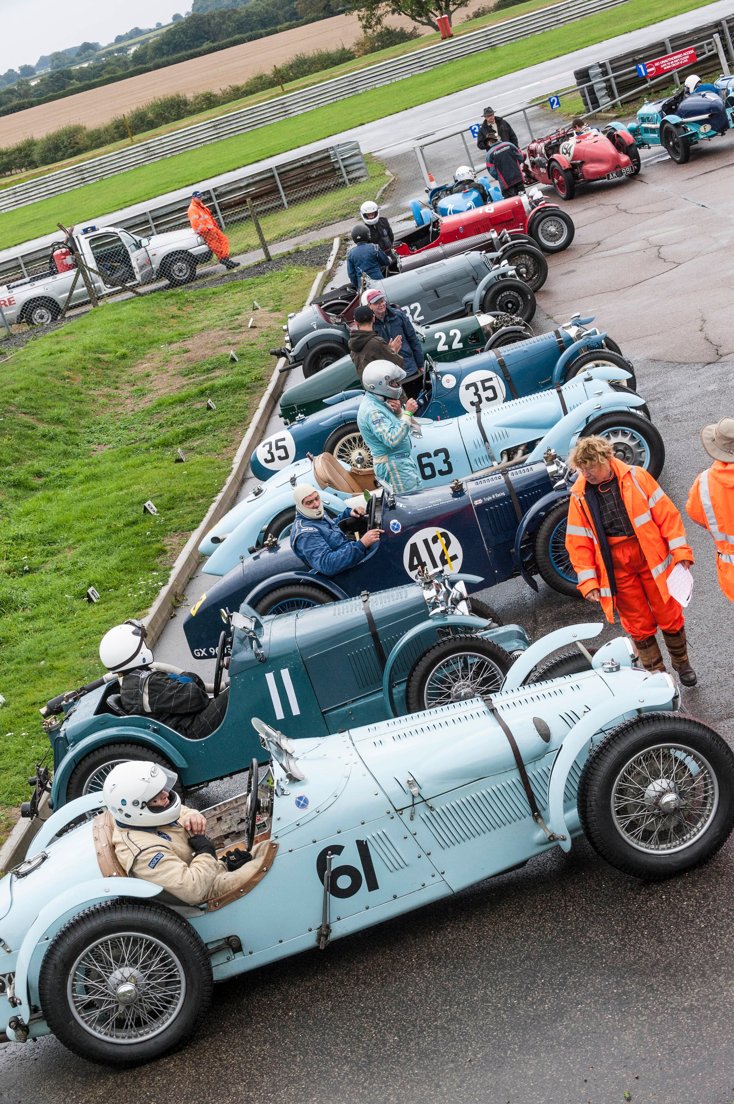 Le Patron in the foreground joins the combatants in assembly, hoping that the rain clouds will pass…………….. Peter McFadyen