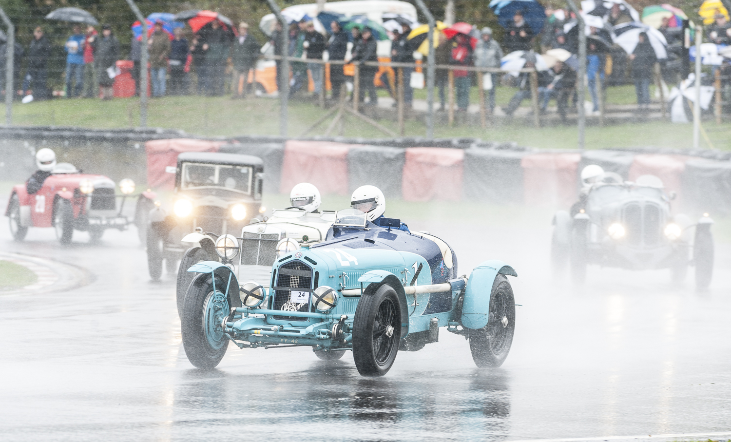 Third placed Mann in the Alfa Monza keeping ahead of the spray:  Peter McFadyen