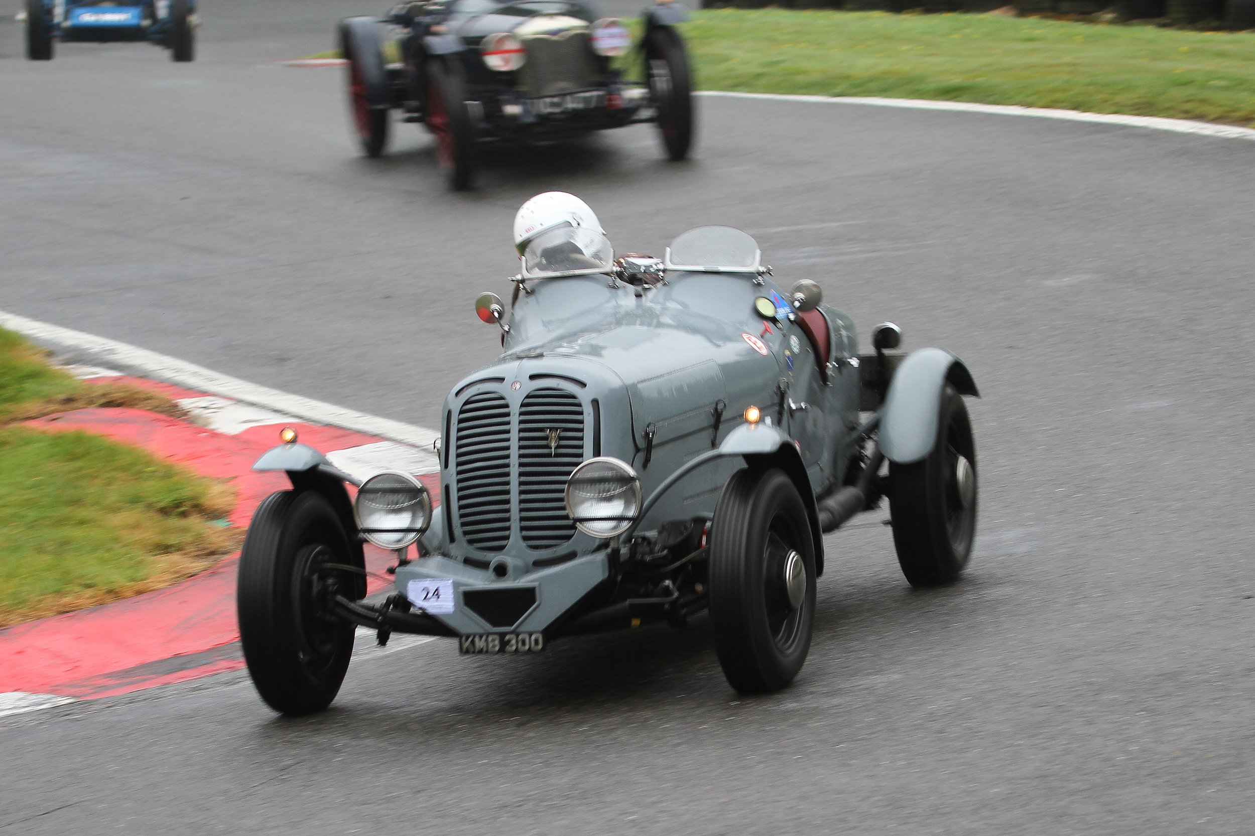 Brett (Ballamy Ford) followed by the Riley Brooklands of Standing and Potter at the foot of the 'Mountain': Stefanie Broch