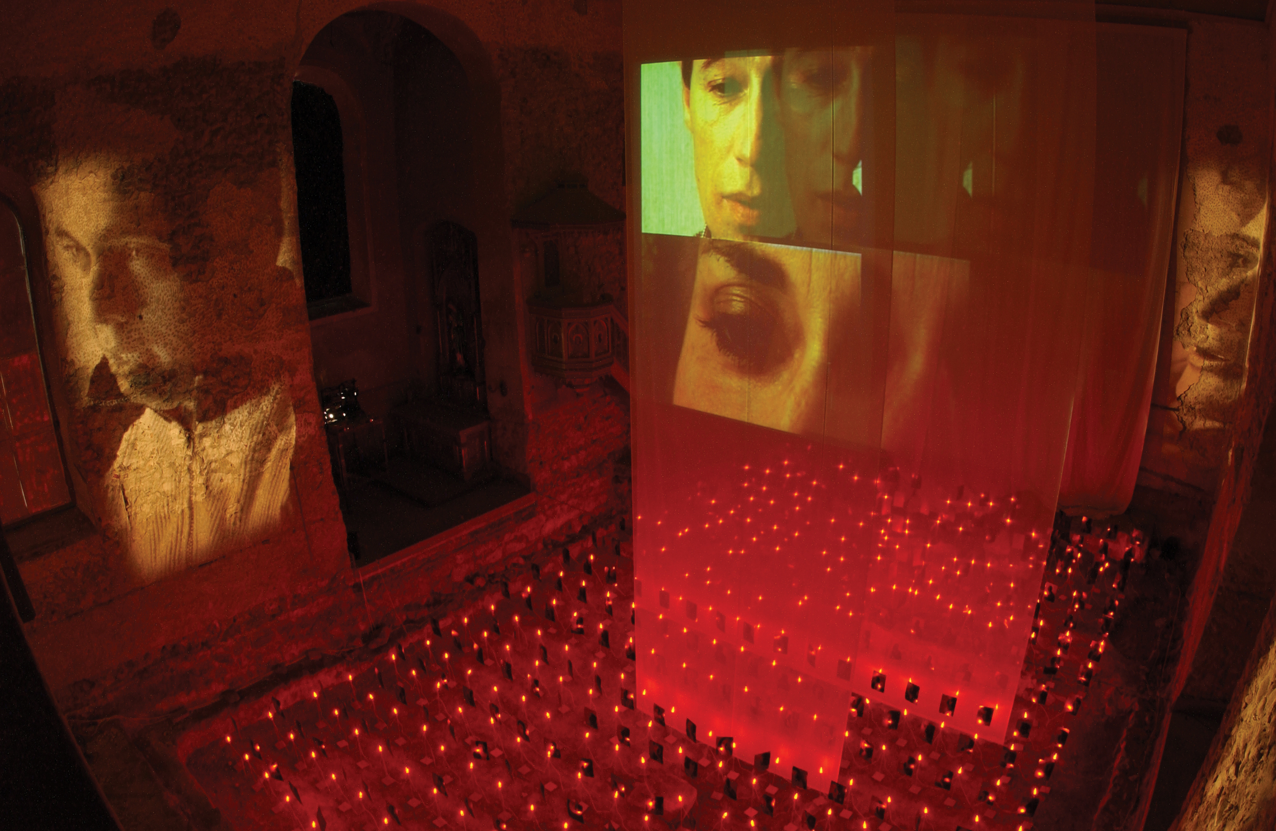 AMEN NEMMEN,   multiple video, audio and slide projection, photography and light  , site specific installation, the Johanniterkirche, Feldkirch, Austria, 2002.   Curator: Eva Jakob