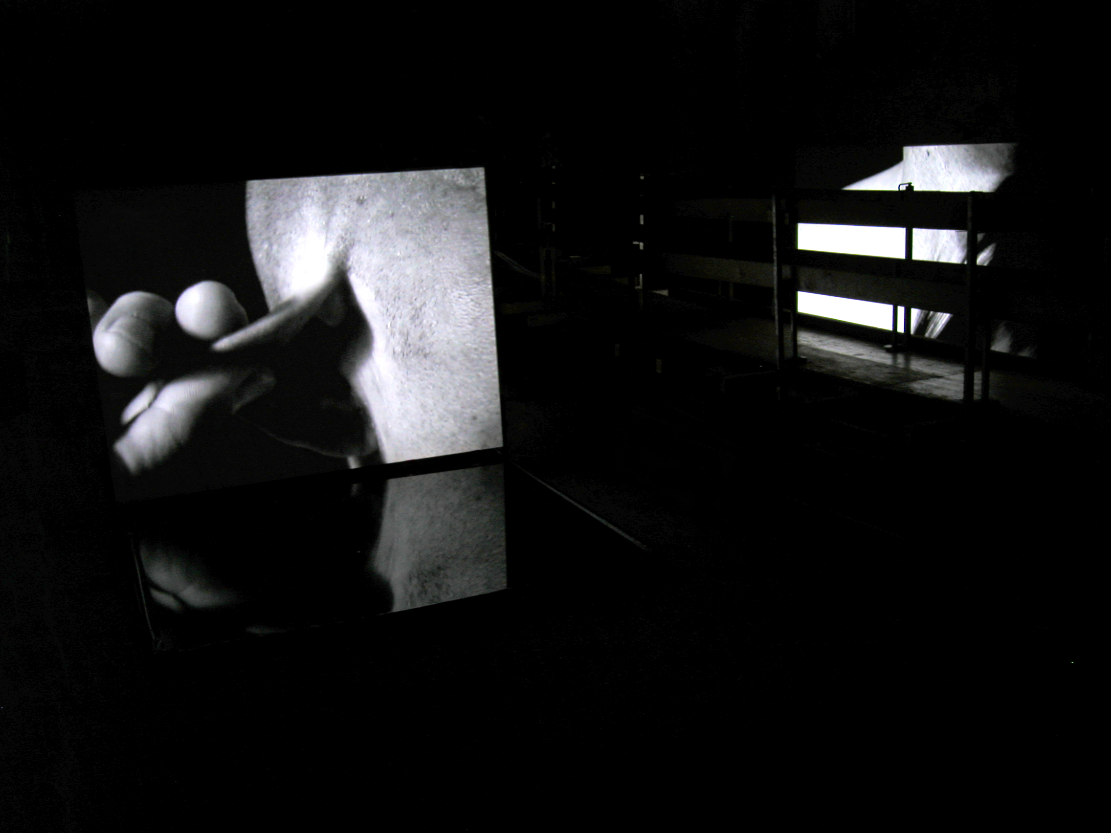 BODY OF GLASS - AFTER CARAVAGGIO,  dual video and stereo audio and water installation,  the Johanniterkirche, Feldkirch, Austria,2006.  Curator: Eva Jakob