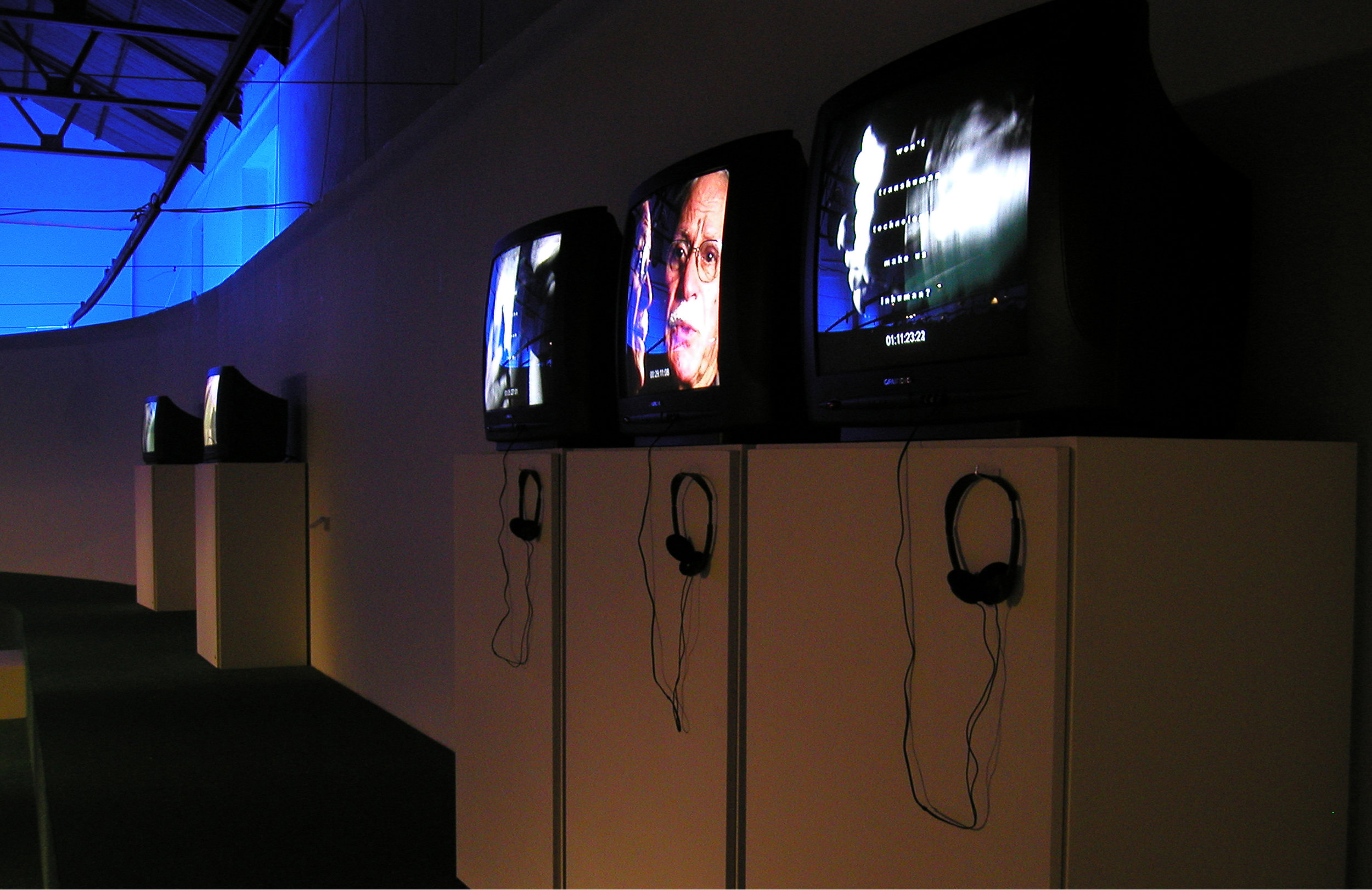 PHOTO FINISH, (Reconfigured version for BODYWORKS exhibition entitled SPIRAL) PAL,three single channel videos, stereo audio,   The Powerhouse, Nicosia Municipal Arts Centre, Cyprus, 2004