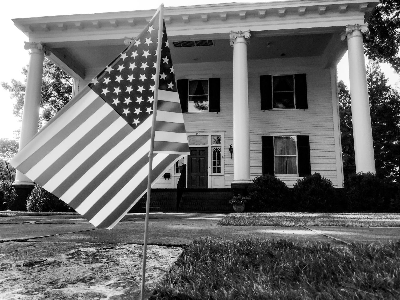 Each year on July 4th, plastic flags dot homes on Walton Street.