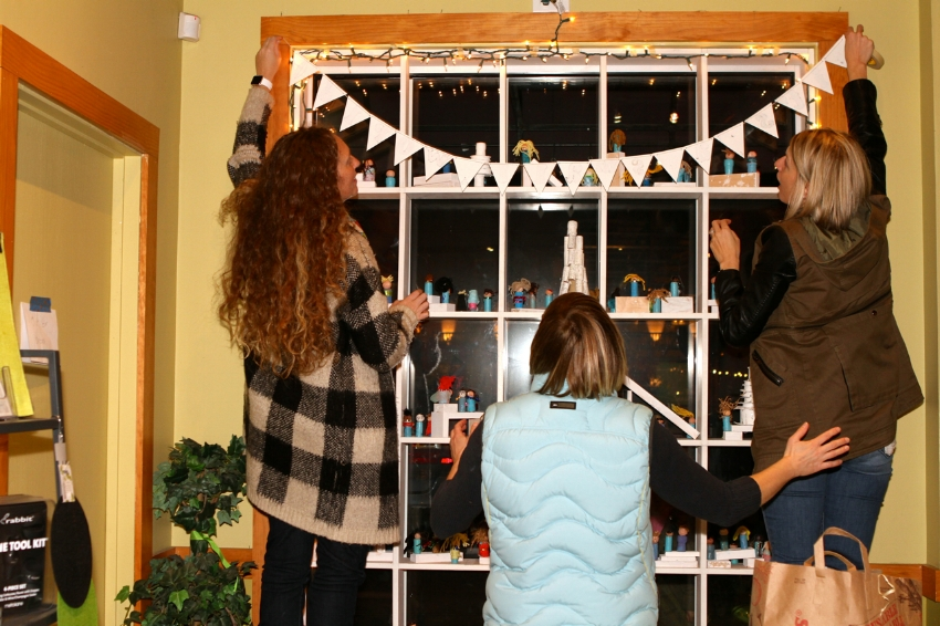 CHES PTA volunteers decorate their window at House Wine