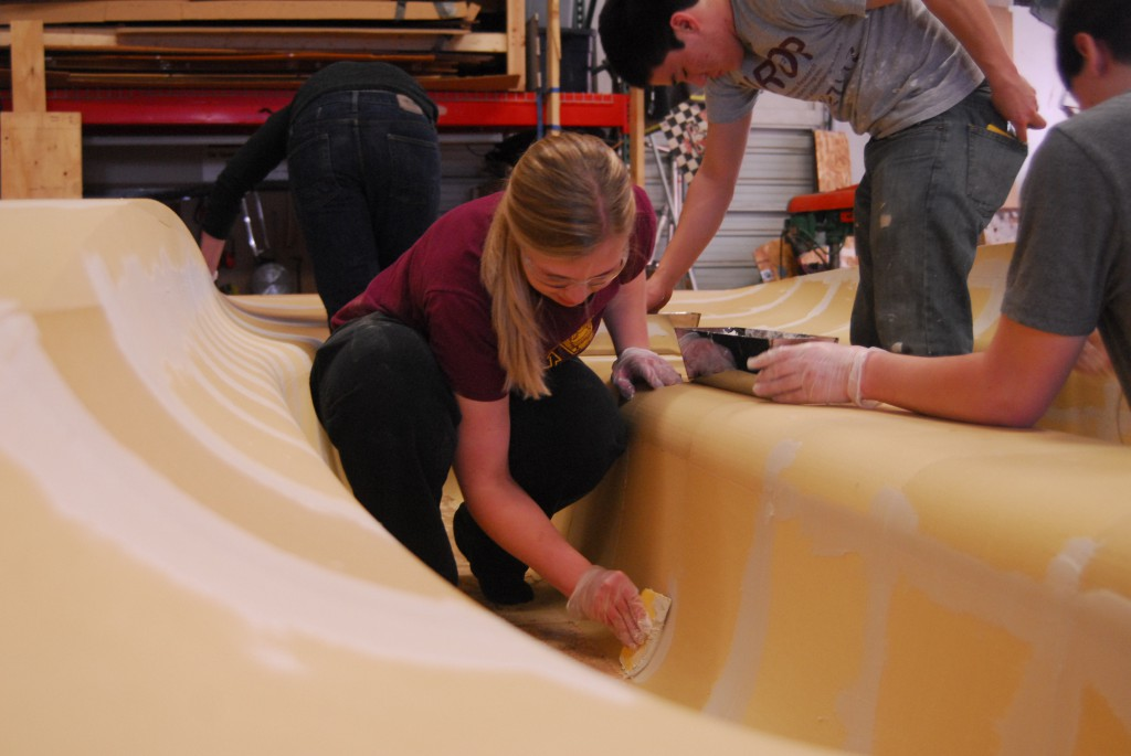 Aero team lead Hannah Mertens leads the effort to finish the mold.