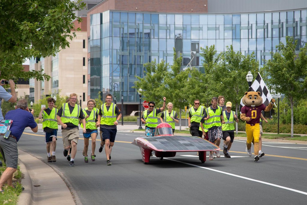 Our team runs with Centaurus III as we cross the finish line in Minneapolis.