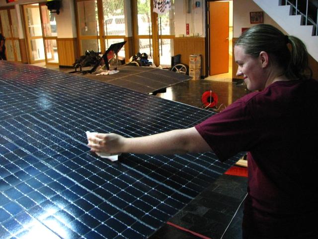 Jessica Lattimer gives the array a bath.