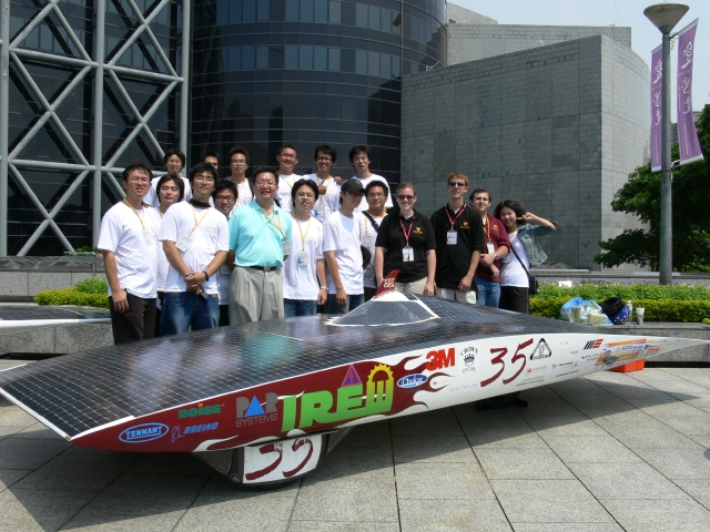 The scrutineering team poses with the car.
