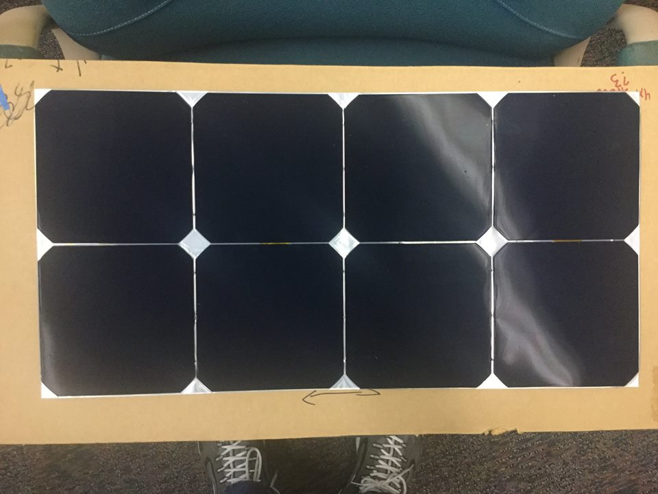 This completed solar module is one of many that make up the photovoltanic array - the car's power source.  Starting from monocrystalline silicon  SunPower solar cells, our students solder eight cells together into a module. Then, we head over to  3M  for encapsulation. Using their films, encapsulant, and facilities, each module is carefully protected from dirt and dust that could cause harm.  Many thanks to 3M for their time, knowledge, materials, and facilities which enable the use of this amazing solar technology!    The Eos II array was made by Gary Peloquin.