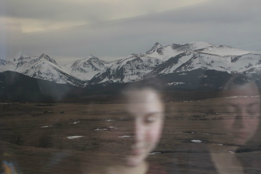 Emily and Ariana reflected in the dining car window