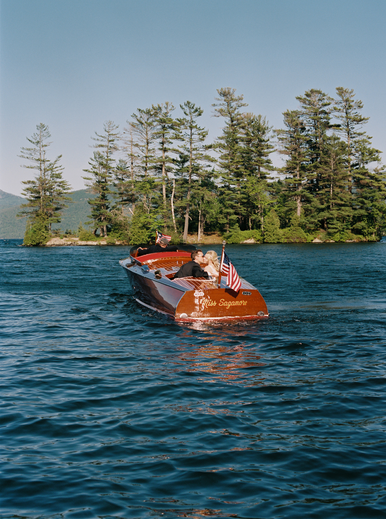 Classic mahogany boats are a summer staple on Lake George. An intimate ride on a vintage Hacker-Craft proved to be one of our favorite moments. There was something so magical about gliding across the crystal clear lake after saying I do.