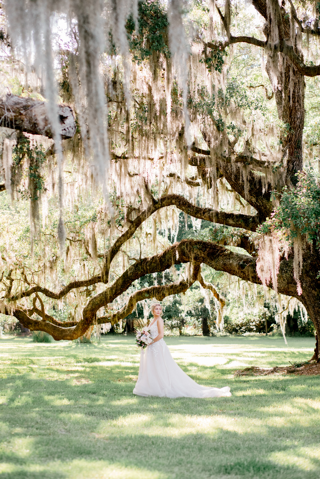 Charleston Flower Girl created the most stunning arrangements. The soft pretty colors where contrasted with deep shades of mauve. A hint of pale blue brought this story to life. The flowers complimented this gorgeous location in the best way possible!