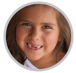 Little girl smiling with gap in teeth