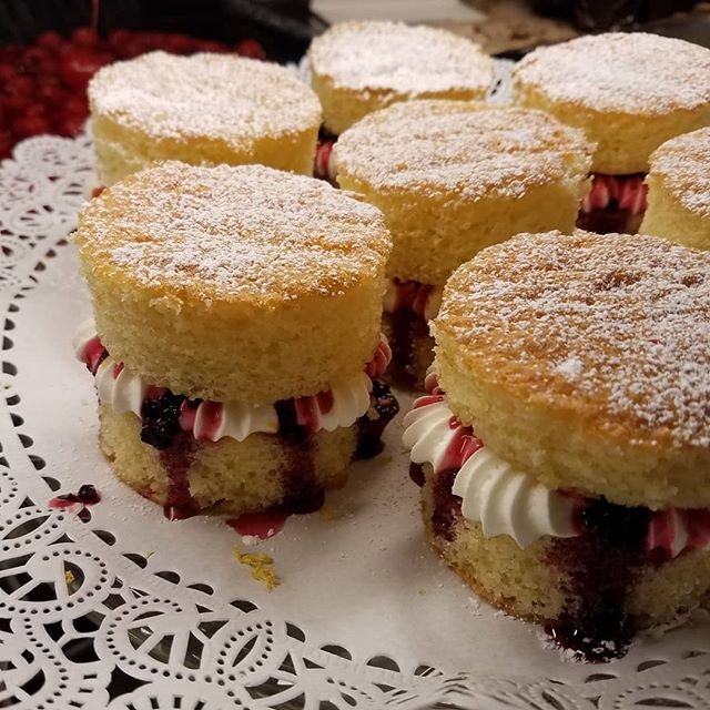 Say hello to these beautiful treats! 😍😍😍 whipped cream and homemade BlackBerry jam sandwiched in between clouds of Victorian spongecake with a kiss of lemon essence 👑💜