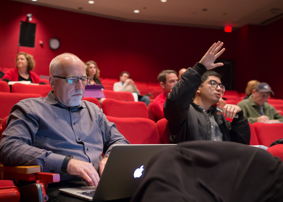Student raising his hand to gain more insight