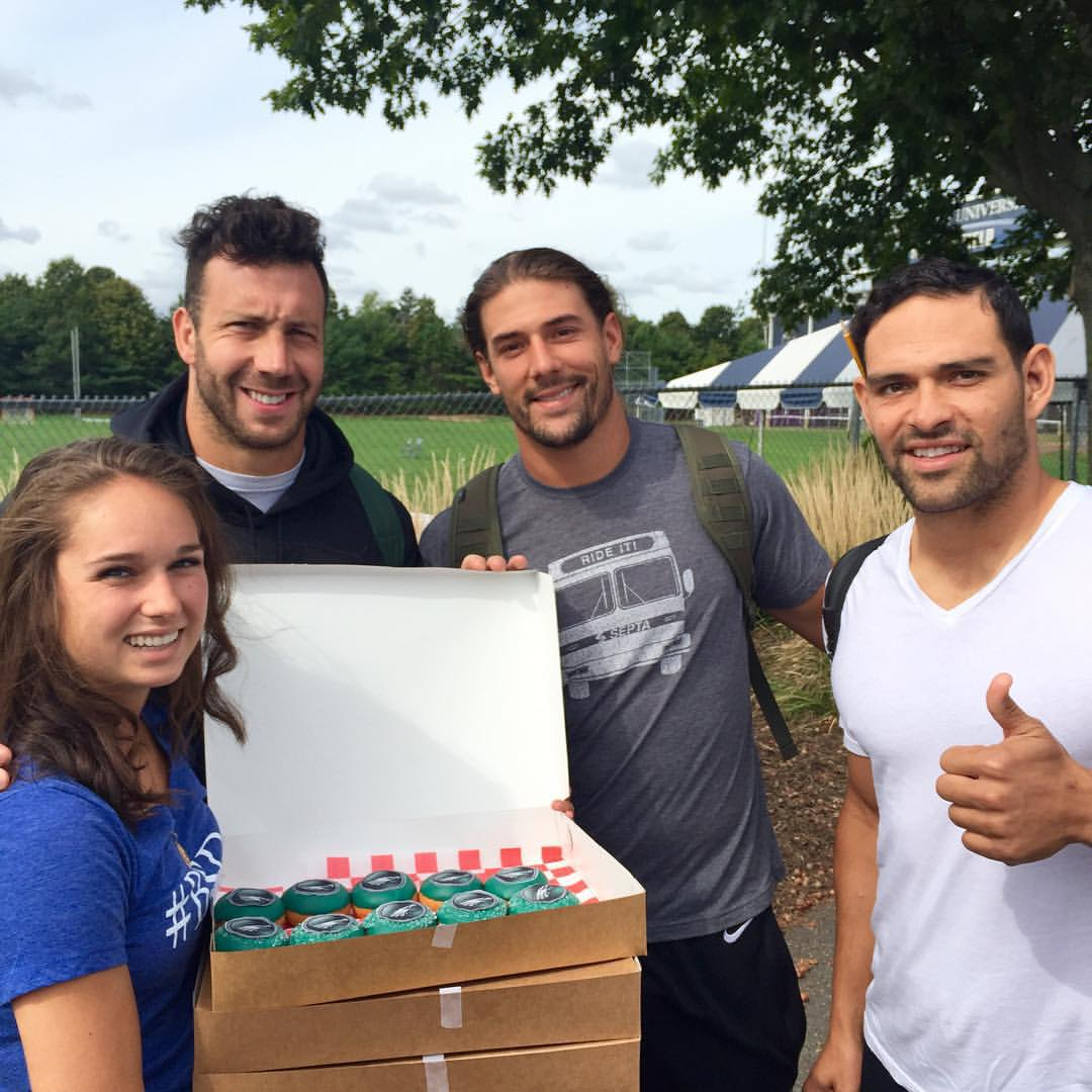 Connor Barwin, Riley Cooper and Mark Sanchez of the Philadelphia Eagles