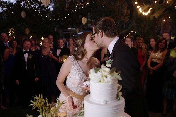 cake_cutting_wedding_reception_string_lights.jpg