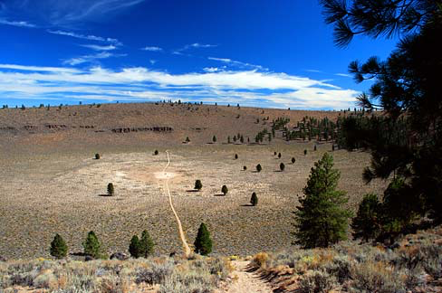 Hole in the Ground  is just a run-of-the-mill extraordinary piece public land on the Deschutes National Forest in Lake County Oregon, where many times over many decades the author has camped either in solitude or with lovers and/or friends on the rim and enjoyed the, scenery, solitude and stars.