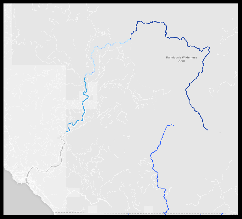 """The Chetco River arises in the Kalmiopsis Wilderness and enters the Pacific Ocean at Brookings. The first 27.5 miles is classified as """"wild"""" under the Wild and Scenic Rivers Act and mining is banned. The next 8 miles is classified as """"scenic"""" and the next 11 miles after that as """"recreational, both of which allow mining on federal public land. The darker grey is Rogue River-Siskiyou National Forest. That other wild and scenic river flowing south off the map into California is the North Fork Smith River. Source: www.rivers.gov."""