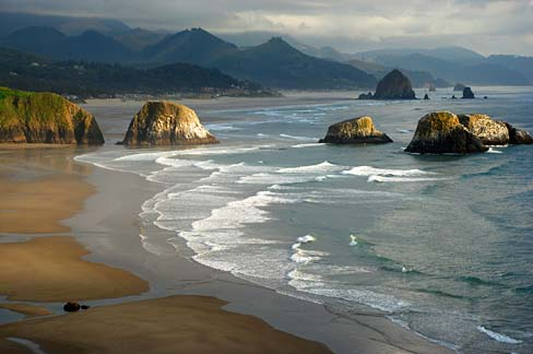 All but a very few islands offshore Oregon are part of the Oregon Islands Wilderness and Oregon Islands National Wildlife Refuge, including these near Ecola Beach State Park. Such protections won't stop and oil spill.  Source: Gary Halvorson, Oregon State Archives