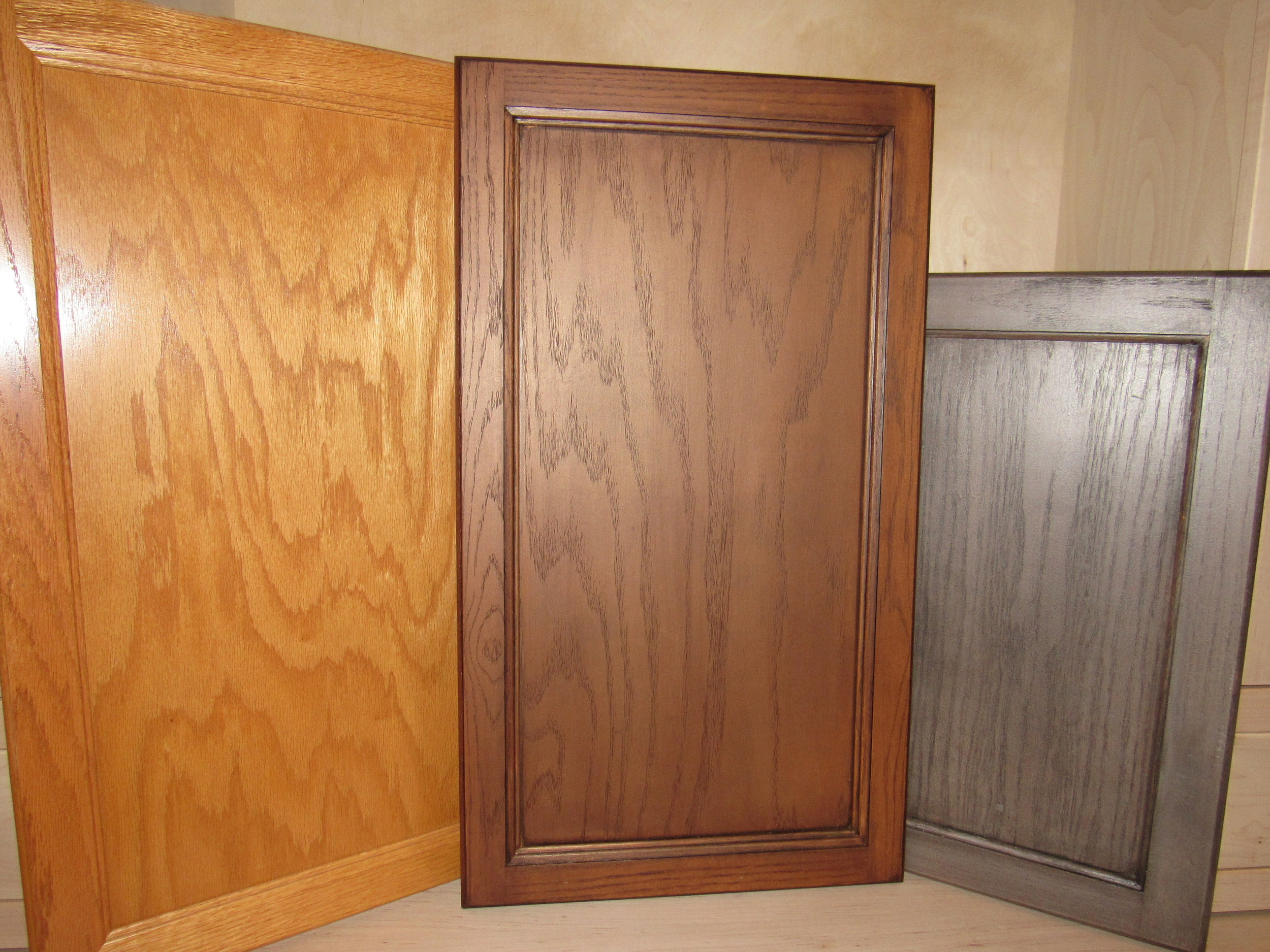 Door on left is original stain (before) while the two doors on the right are the Re-Stained finished (after).