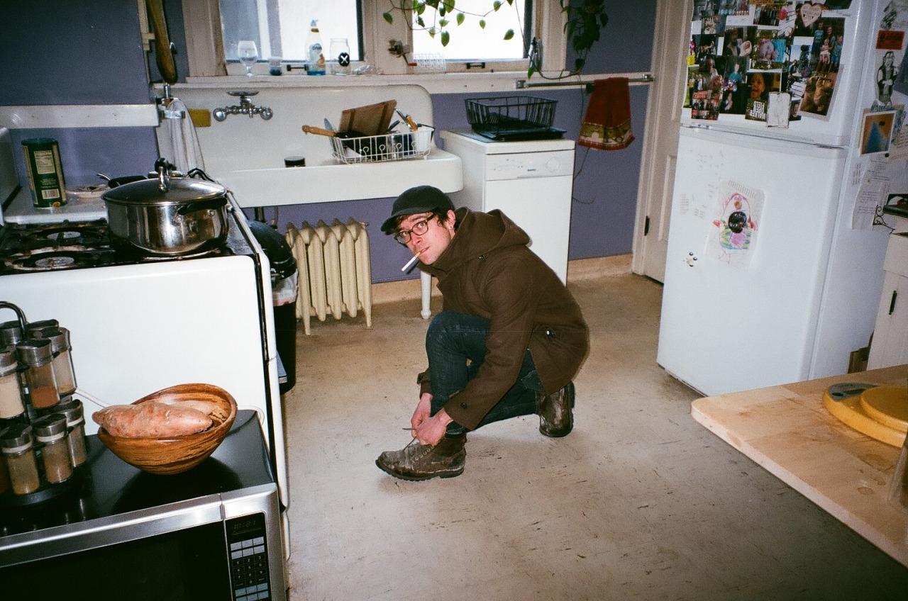 Derek in the kitchen with a cigarette