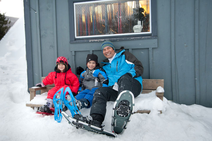 Snowshoeing Dad with kids at Smuggler's Notch Resort
