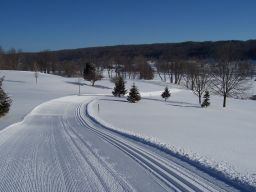 Groomed trail with blue skies at  Byrncliff Resort & Conference Center