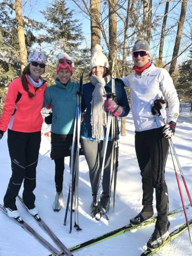 Trailside family pose at Maplelag Resort