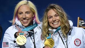 Kikkan Randall and Jessie Diggins show their gold