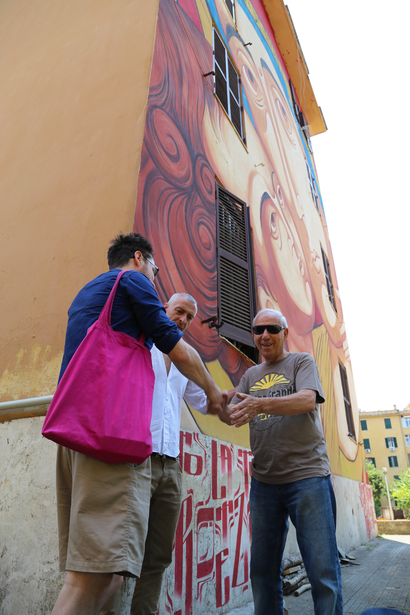 Brad onsite with Stefano Antonelli during his installation on the Big City Life project. Both connecting with a resident who later sang us a song.A palpable sense of excitement and renewed sense of community was present. Amazing work being done here!o