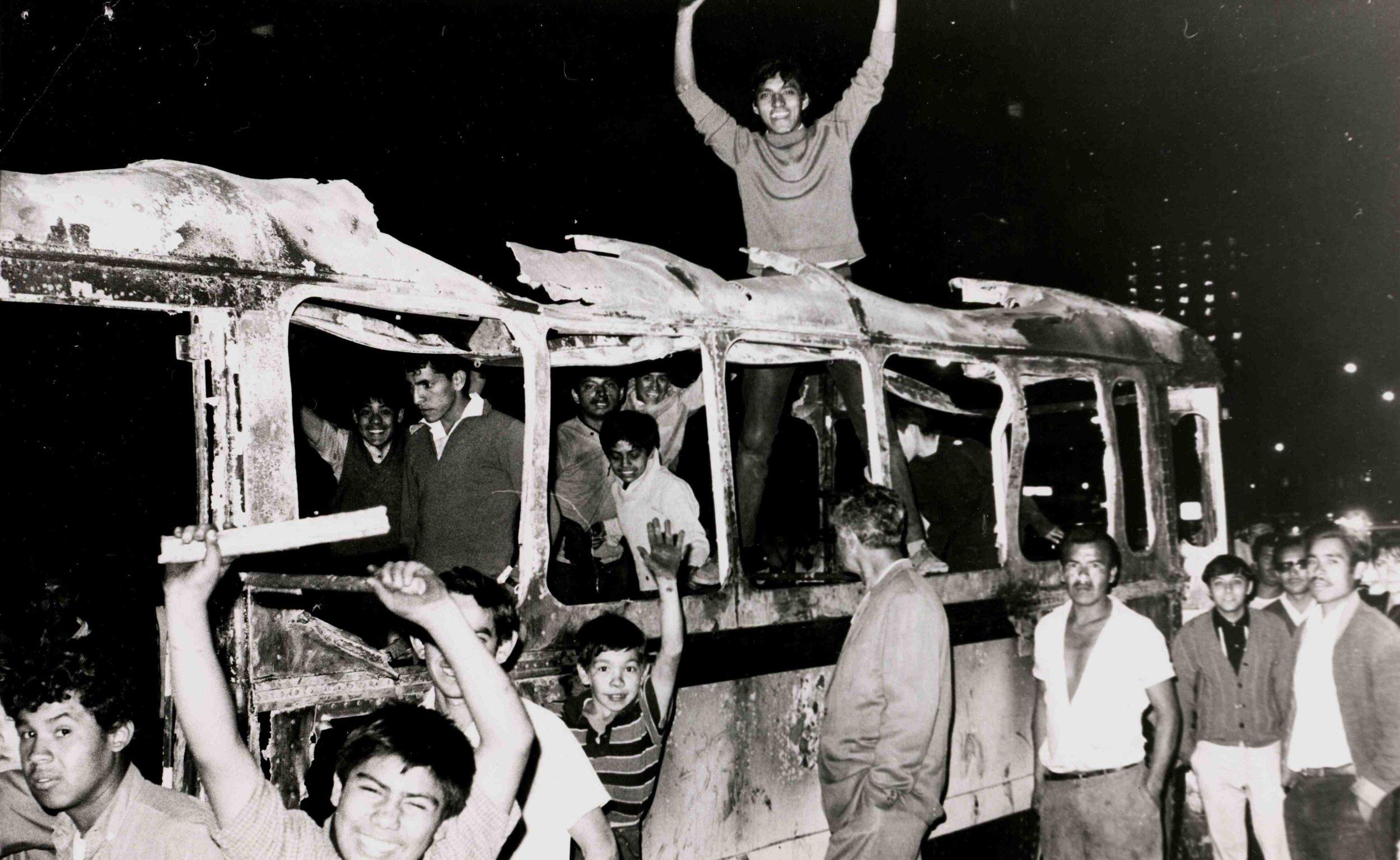 10,000 students gathered in Plaza de Las Tres Culturas during the '68 Tlatelolco Massacre, demanding ' No queremos olimpiadas, queremos revolución! '