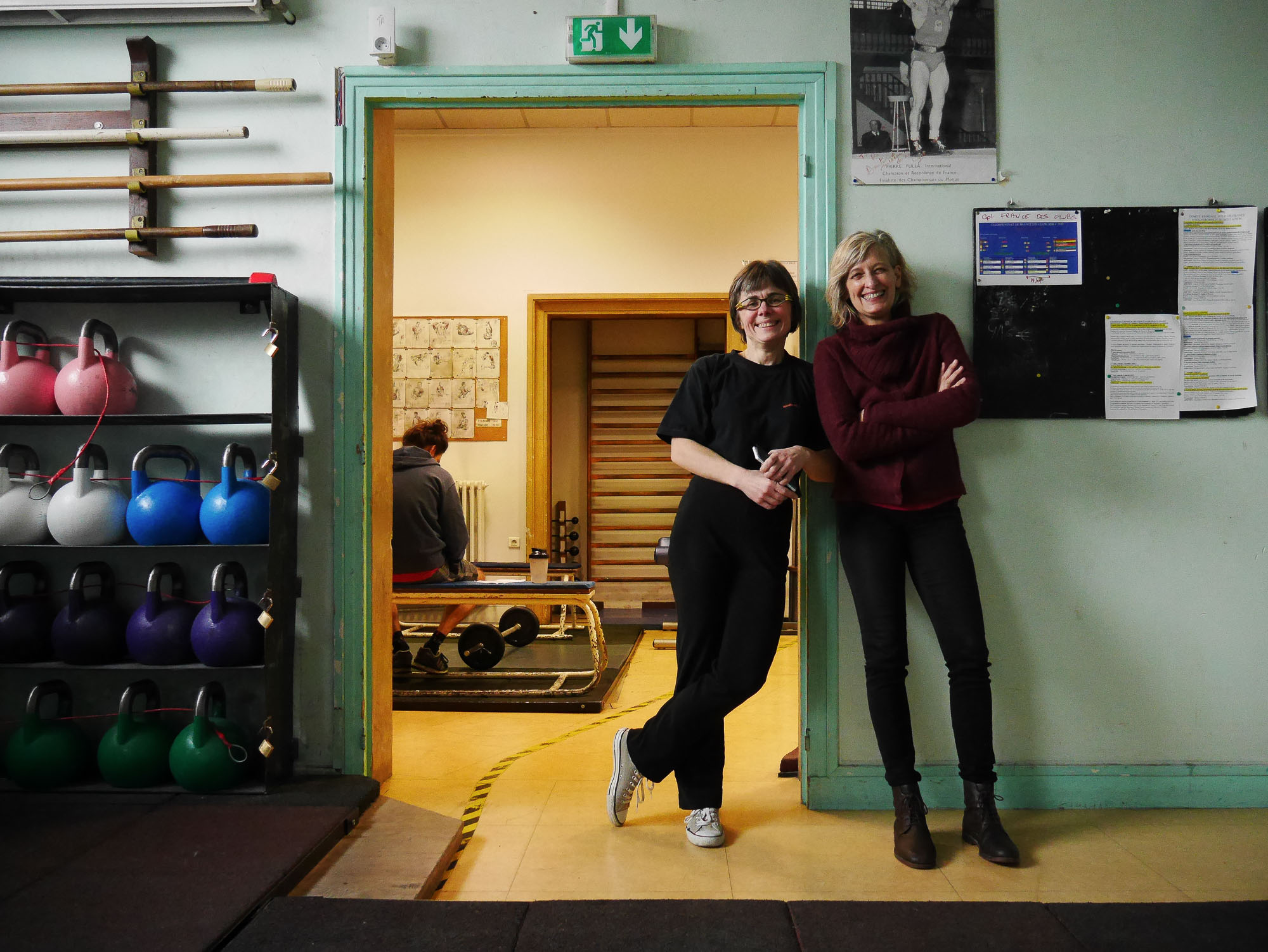 Marie stands with Nina — the world champion in kettle-bells — 'It's training for life. For military training, for having children, all of these. It's based on the way bodies get used. You can also do power juggling with it! 'In State Academy of Physical Culture in Ukraine we studied history of the Olympic games and I read about this club. So when I came to France I thought 'this was the club I read about and am very fond of!' Why it is interesting? Because Pierre de Coubertin created a modern building, started the modern Olympics. So it is like the culture of the place. It has a story. That's the difference.'