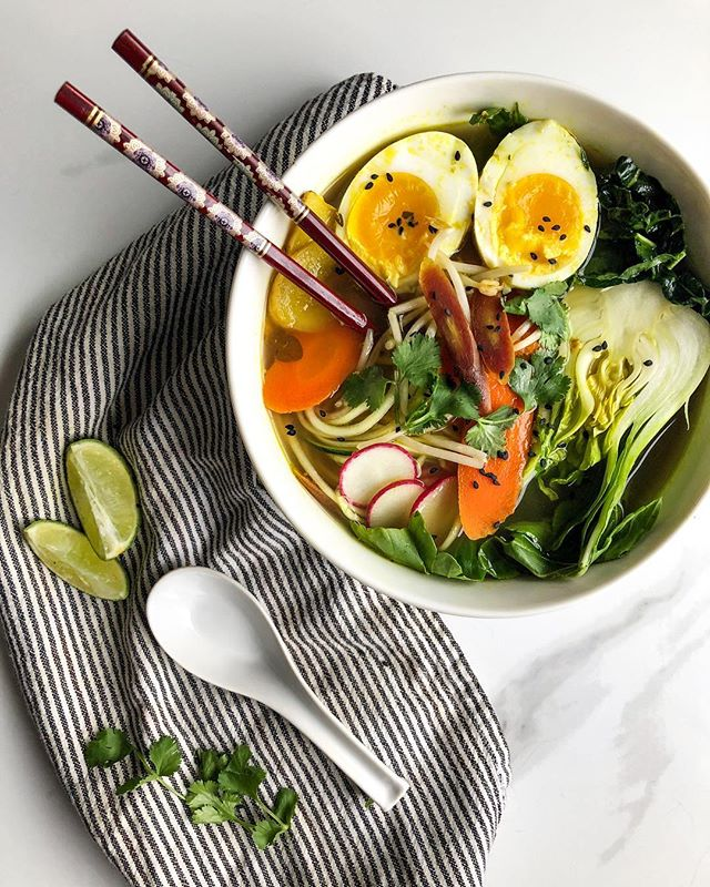 Paleo Bone Broth Pho 🍲 with a soft-boiled duck egg is everything I need on this grey rainy Vancouver day! Fodmap and nightshade free, this bowl of warm bowl of goodness is anti-inflammatory and packed with gut restorative amino acids. Last week we roasted two organic pasture raised chickens and after pulling off all the meat, I saved the bones to make a 24-hour batch of bone broth. I've been sipping on it on its' own and making quick soups for the past few days. A rich broth is the key ingredient to good cooking! Recipe for making this Paleo Bone Broth Pho here: 1) Start by heating up 2.5 cups of broth on the stove, add in any spices you'd like such as turmeric, black pepper or salt. 2) Using a spiralizer, prepare zucchini noodles. 3) Chop your veggies and throw any hardier veg into the broth once it begins to boil. 4) Rinse outer shell of your egg and gently place in boiling broth. 5) Add zucchini noodles and remaining veg to pot. 6) Turn off the element, cover and let sit for 12 minuets. 7) Remove egg from broth and set in ice bath to stop it from cooking. 8) Gently peel off shell of egg and slice in half. 9) Garnish with Thai basil, cilantro, bean sprouts and/or sesame seeds. 10) Enjoy that mother f***er! . . . . . . .